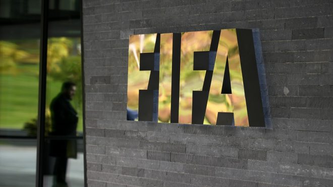 (FILES) This file photo taken on October 13, 2016 shows a sign of the FIFA  at the entrance of the world football's governing body headquarters in Zurich. World football's governing body FIFA on Friday announced a record $369 million loss for 2016 as it paid for the fallout from multiple scandals and bad investments. FIFA blamed accounting changes as well as the cost of investigating the scandals for the loss but also warned that it expected a higher loss of $489 million for 2017 and admitted that it has had to spend hundreds of millions of dollars from its reserves in the past year.  / AFP PHOTO / FABRICE COFFRINI