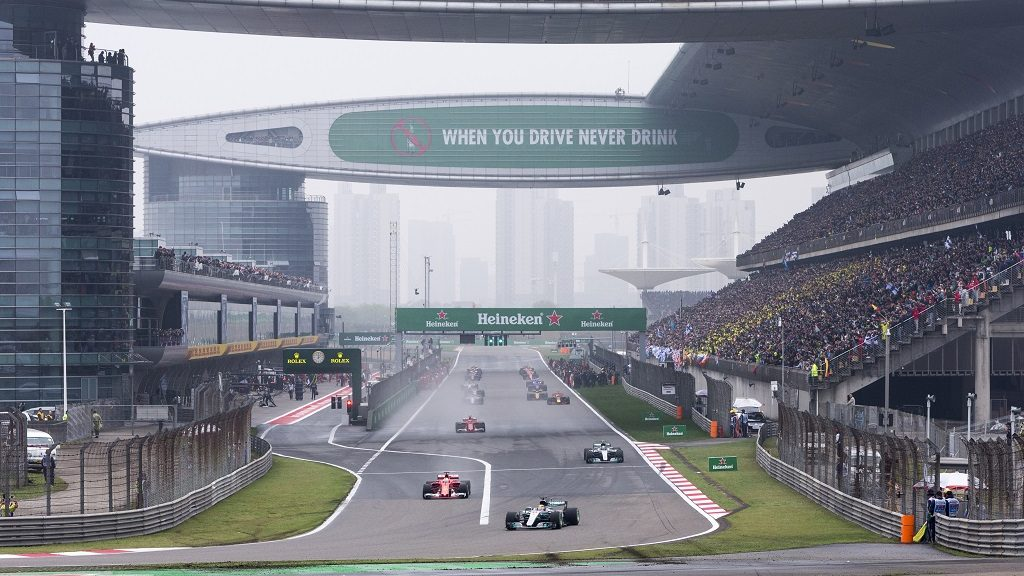 F1 racers compete during the 2017 Formula One Chinese Grand Prix at the Shanghai International Circuit in Shanghai, China, 9 April 2017.  With Lewis Hamilton and Sebastian Vettel starting side-by-side on the front row at the Chinese Grand Prix on Sunday, the stage was set for a wheel-to-wheel duel between long-dominant Mercedes and a newly competitive Ferrari. A chaotic start to the race on a wet track, however, scuttled the highly anticipated showdown as Hamilton coasted to victory for his fifth title in Shanghai and first of the new Formula One season. Starting from pole position, Hamilton led from beginning to end to capture the race in 1 hour, 37 minutes, 36.158 seconds and pull even with Vettel atop the driver's standings with 43 points. Two weeks after beating Hamilton at the season-opening Australian GP, Vettel had to settle for second place this time, finishing 6.2 seconds behind his rival. With both teams showing equal pace at the top, there will likely be plenty of other opportunities for close races this season.