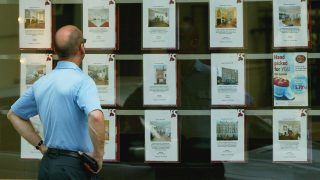 LONDON - JULY 10:  A man looks at properties for sale in an estate agents window July 10, 2003 in London, England. House price growth slowed in June but the property market remains well supported, according to the latest survey from the Halifax with prices having risen by 21.9% over the past year. (Photo by Scott Barbour/Getty Images)