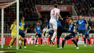 Hoffenheim's goalkeeper Oliver Baumann (l) holds a header from Dominique Heintz (r) during the German Bundesliga soccer match between 1. FC Cologne and TSG Hoffenheim in the RheinEnergieStadion stadium in Cologne, Germany, 21 April 2017. 