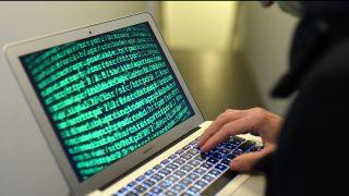 """Illustration of cybercrime (Photo credit should read """"HELMUT FOHRINGER/APA-PictureDesk via AFP"""")"""