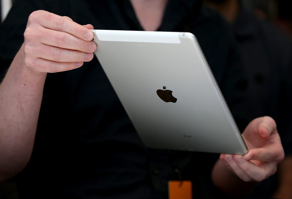 CUPERTINO, CA - OCTOBER 16: An attendee inspects new iPad Air 2 during an Apple special event on October 16, 2014 in Cupertino, California. Apple unveiled the new iPad Air 2 and iPad Mini 3 tablets and the iMac with 5K retina display.   Justin Sullivan/Getty Images/AFP