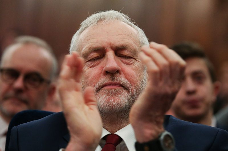 Britain's opposition Labour Party leader Jeremy Corbyn applauds in his seat before delivering a speech about Labour's vision for a post-Brexit Britain in central London on February 24, 2017.  / AFP PHOTO / Daniel LEAL-OLIVAS