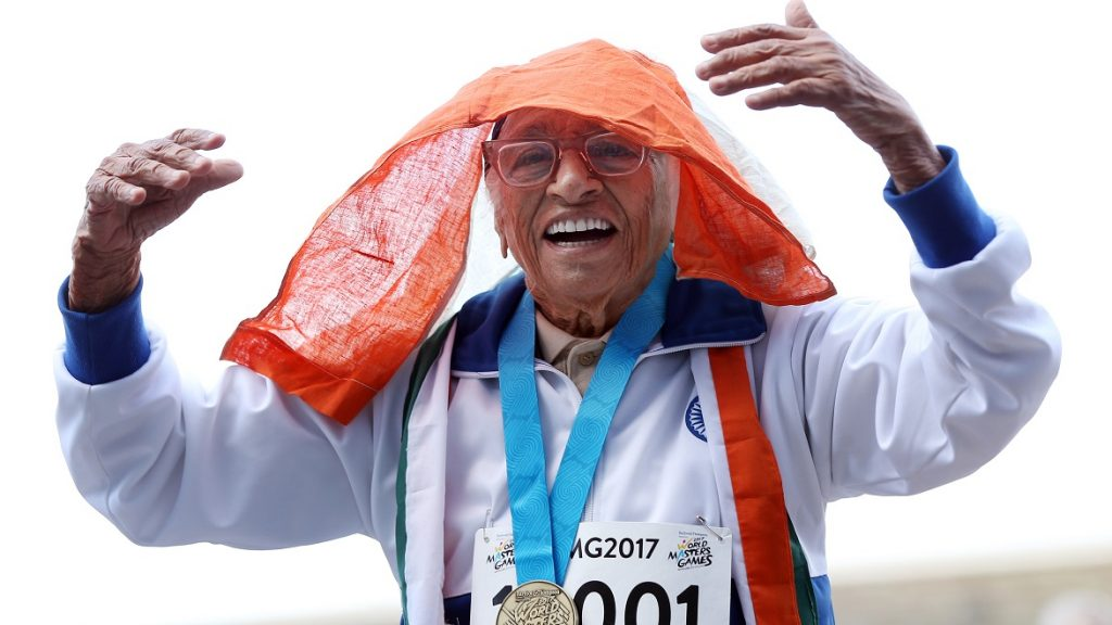 101-year-old Man Kaur from India celebrates after competing in the 100m sprint in the 100+ age category at the World Masters Games at Trusts Arena in Auckland on April 24, 2017. / AFP PHOTO / MICHAEL BRADLEY