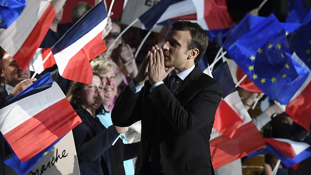 French presidential election candidate for the En Marche ! movement Emmanuel Macron reacts as he gives a speech during a meeting in Arras, on April 26, 2017, ahead of the second and final round of the presidential election. / AFP PHOTO / Eric FEFERBERG