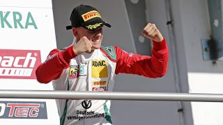 The winner of the last race, Mick Schumacher from the Prema Powerteam, cheers during the victory ceremony at the ADAC Formula 4 last run of the season in Hockenheim,Germany, 02 October 2016. Photo:RONALDWITTEK/dpa