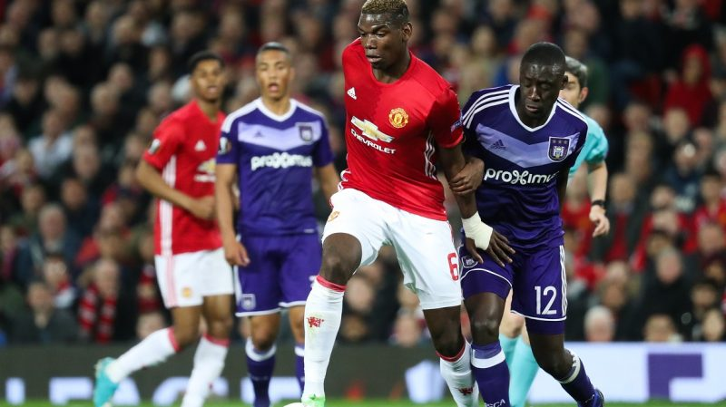 Manchester's Paul Pogba and Anderlecht's Dennis Appiah fight for the ball during the return leg game of the quarterfinals of the Europa League competition between UK team Manchester United and Belgian soccer team RSC Anderlecht in Manchester, UK, Thursday 20 April 2017. First leg ended on a draw result 1-1 in Belgium. BELGA PHOTO VIRGINIE LEFOUR