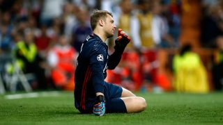 Bayern Munich's goalkeeper Manuel Neuer sits on the field during the UEFA Champions League quarter-final second leg football match Real Madrid vs FC Bayern Munich at the Santiago Bernabeu stadium in Madrid in Madrid on April 18, 2017. / AFP PHOTO / OSCAR DEL POZO