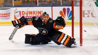 PITTSBURGH, OH - FEBRUARY 25: Michal Neuvirth #30 of the Philadelphia Flyers is unable to stop a shot from Nick Bonino #13 of the Pittsburgh Penguins during the second period at Heinz Field on February 25, 2017 in Pittsburgh, Pennsylvania.   Kirk Irwin/Getty Images/AFP