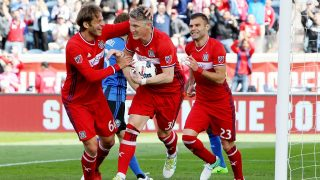 BRIDGEVIEW, IL - APRIL 1: Bastian Schweinsteiger #31 of Chicago Fire celebrates with Joao Meira #66 and Nemanja Nikolic #23 after scoring a goal in the first half against the Montreal Impact during an MLS match at Toyota Park on April 1, 2017 in Bridgeview, Illinois.   Dylan Buell/Getty Images/AFP