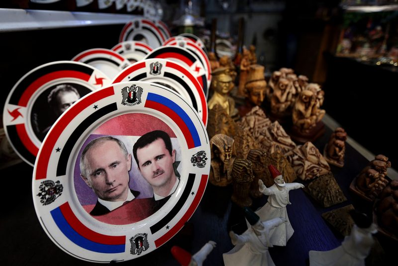 Porcelain plates bearing portraits of Syrian President Bashar al-Assad (R) and his Russian counterpart Vladimir Putin (L) are displayed at a handicrafts shop in the Syrian capital, Damascus, on February 4, 2016. Syrian government troops moved closer to encircling rebels in the country's second city Aleppo, threatening a total siege after cutting their main supply line.  / AFP PHOTO / JOSEPH EID
