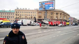 Emergency vehicles and a helicopter are seen at the entrance to Technological Institute metro station in Saint Petersburg on April 3, 2017.