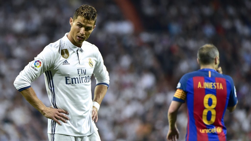 Real Madrid's Portuguese forward Cristiano Ronaldo stands on the field during the Spanish league football match Real Madrid CF vs FC Barcelona at the Santiago Bernabeu stadium in Madrid on April 23, 2017. / AFP PHOTO / GERARD JULIEN