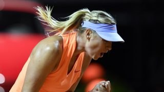 Russian tennis player Maria Sharapova reacts as she plays against Roberta Vinci of Italy  at the WTA Tennis Grand Prix in Stuttgart, southern Germany, on April 26, 2017. / AFP PHOTO / THOMAS KIENZLE