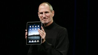 Apple Inc. CEO Steve Jobs announces the new iPad as he speaks during an Apple Special Event at Yerba Buena Center for the Arts January 27, 2010 in San Francisco, California. Apple introduced its latest creation, the iPad, a mobile tablet browsing device that is a cross between the iPhone and a MacBook laptop. AFP PHOTO/RYAN ANSON / AFP PHOTO / Ryan Anson