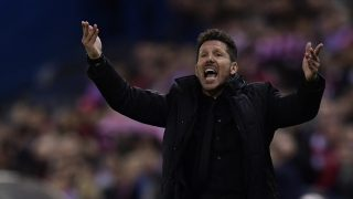 Atletico Madrid's Argentinian coach Diego Simeone shouts instructions from the sideline during the Spanish league football match Club Atletico de Madrid vs Real Sociedad at the Vicente Calderon stadium in Madrid on April 4, 2017. / AFP PHOTO / JAVIER SORIANO