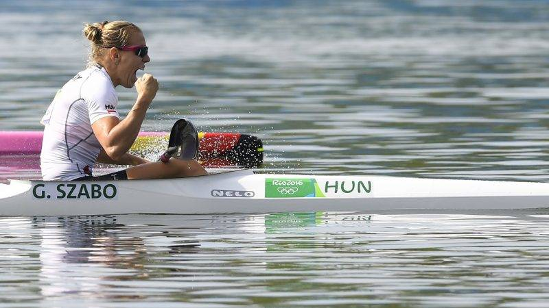Hungary's Gabriella Szabo celebrates after the Women's Kayak Double (K2) 500m final at the Lagoa Stadium during the Rio 2016 Olympic Games in Rio de Janeiro on August 16, 2016. / AFP PHOTO / Damien MEYER