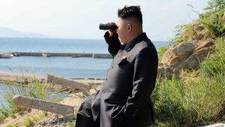 """This undated picture released from North Korea's official Korean Central News Agency (KCNA) on July 7, 2014 shows North Korean leader Kim Jong-Un inspecting the defence detachment on Ung Islet, defending an outpost in the East Sea of Korea.   AFP PHOTO / KCNA via KNS    REPUBLIC OF KOREA OUT -- THIS PICTURE WAS MADE AVAILABLE BY A THIRD PARTY. AFP CAN NOT INDEPENDENTLY VERIFY THE AUTHENTICITY, LOCATION, DATE AND CONTENT OF THIS IMAGE. THIS PHOTO IS DISTRIBUTED EXACTLY AS RECEIVED BY AFP. ---EDITORS NOTE--- RESTRICTED TO EDITORIAL USE - MANDATORY CREDIT """"AFP PHOTO / KCNA VIA KNS"""" - NO MARKETING NO ADVERTISING CAMPAIGNS - DISTRIBUTED AS A SERVICE TO CLIENTS / AFP PHOTO / KCNA / KNS"""