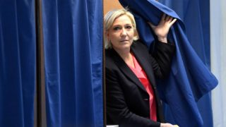 French presidential election candidate for the far-right Front National (FN - National Front) party Marine Le Pen walks out a polling booth at a polling station in Henin-Beaumont, north-western France, on May 7, 2017, during the second round of the French presidential election. / AFP PHOTO / ALAIN JOCARD