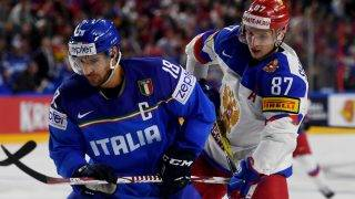 Russia´s Vadim Shipachyov (R) and Italy´s Anton Bernard vie for the puck during IIHF Ice hockey world championship first round match between Russia and Italy in the LANXESS arena in Cologneon May 7, 2017. / AFP PHOTO / PATRIK STOLLARZ