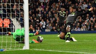 Chelsea's Belgian striker Michy Batshuayi (R) scores the opening goal during the English Premier League match between West Bromwich Albion and Chelsea at The Hawthorns stadium in West Bromwich, west Midlands on May 12, 2017. / AFP PHOTO / Anthony Devlin