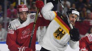 Denmark´s Markus Lauridsen and Germany´s Brooks Macek vie during the IIHF Ice Hockey World Championships first round match between Germany and Denmark in Cologne, western Germany on May 12, 2017. / AFP PHOTO / PATRIK STOLLARZ