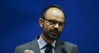 """(FILES) This file photo taken on May 11, 2017 shows Mayor of Le Havre Edouard Philippe speaking as he presents the candidates for the """"La Republique en marche"""" party ahead of the June parliamentary elections (legislative) in Le Havre, northwestern France. / AFP PHOTO / CHARLY TRIBALLEAU"""