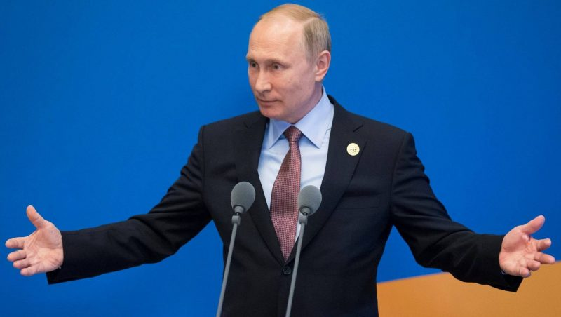 Russian President Vladimir Putin gestures while speaking to the media after the Belt and Road Forum at the China National Convention Center at the Yanqi Lake venue outside Beijing on May 15, 2017. / AFP PHOTO / POOL / Alexander Zemlianichenko
