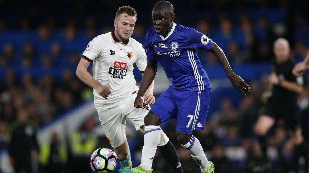 Chelsea's French midfielder N'Golo Kante (R) plays the ball under pressure from Watford's English mifielder Tom Cleverley (L) during the English Premier League football match between Chelsea and Watford at Stamford Bridge in London on May 15, 2017. / AFP PHOTO / Adrian DENNIS / RESTRICTED TO EDITORIAL USE. No use with unauthorized audio, video, data, fixture lists, club/league logos or 'live' services. Online in-match use limited to 75 images, no video emulation. No use in betting, games or single club/league/player publications.  /