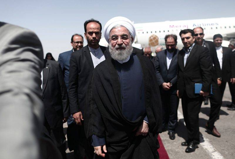 Iranian President and candidate in the upcoming presidential elections Hassan Rouhani walks at the tarmac at the Hasheminejad international airport in the northeastern city of Mashhad on May 17, 2017.