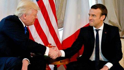 US President Donald Trump (L) shakes hands with French President Emmanuel Macron ahead of a working lunch, at the US ambassador's residence, on the sidelines of the NATO (North Atlantic Treaty Organization) summit, in Brussels, on May 25, 2017.  / AFP PHOTO / POOL / Peter Dejong
