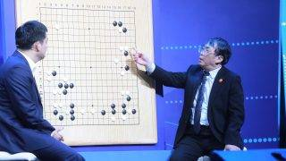 Experts review moves during the Go match between 19-year-old Ke Jie and Google's artificial intelligence programme AlphaGo in Wuzhen, in eastern China's Zhejiang province on May 27, 2017.  The Google-owned computer algorithm AlphaGo is retiring from playing humans in the ancient Chinese game of Go after roundly defeating the world's top player this week, its developer said on May 27. / AFP PHOTO / STR / China OUT