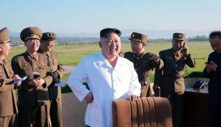 """This undated picture released from North Korea's official Korean Central News Agency (KCNA) on May 28, 2017 shows North Korean leader Kim Jong-Un (C) inspecting the test of a new anti-aircraft guided weapon system organized by the Academy of National Defence Science at an undisclosed location. North Korean leader Kim Jong-Un has overseen a test of a new anti-aircraft weapon system, state media said on May 28, amid mounting tensions in the region following a series of missile tests by Pyongyang. / AFP PHOTO / KCNA VIA KNS / STR /  - South Korea OUT / REPUBLIC OF KOREA OUT   ---EDITORS NOTE--- RESTRICTED TO EDITORIAL USE - MANDATORY CREDIT """"AFP PHOTO/KCNA VIA KNS"""" - NO MARKETING NO ADVERTISING CAMPAIGNS - DISTRIBUTED AS A SERVICE TO CLIENTS THIS PICTURE WAS MADE AVAILABLE BY A THIRD PARTY. AFP CAN NOT INDEPENDENTLY VERIFY THE AUTHENTICITY, LOCATION, DATE AND CONTENT OF THIS IMAGE. THIS PHOTO IS DISTRIBUTED EXACTLY AS RECEIVED BY AFP.  /"""