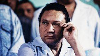 (FILES) This file photo taken on March 07, 1988 shows Panama's general Manuel Antonio Noriega attending an anti-US meeting in Panama city. Manuel Antonio Noriega, who took power in Panama in 1983 and was ousted by US forces in 1989, died late Monday, May 29, 2017 in Panama City, a government official said. He was 83. Noriega was in a hospital recovering from a brain tumor operation. The announcement was made by government communications secretary Manuel Dominguez.  / AFP PHOTO / GUILLERMO ENDARA