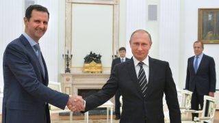 """Russian President Vladimir Putin (R) shakes hands with his Syrian counterpart Bashar al-Assad (L) during a meeting at the Kremlin in Moscow on October 20, 2015. Assad, on his first foreign visit since Syria's war broke out, told his main backer and counterpart Putin in Moscow that Russia's campaign in Syria has helped contain """"terrorism"""". AFP PHOTO / RIA NOVOSTI / KREMLIN POOL / ALEXEY DRUZHININ / AFP PHOTO / RIA NOVOSTI / ALEXEY DRUZHININ"""