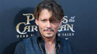 """American actor Johnny Depp arrives on the red carpet for the premiere of his new movie """"Pirates of the Caribbean: Dead Men Tell No Tales"""" in Shanghai, China, 11 May 2017."""