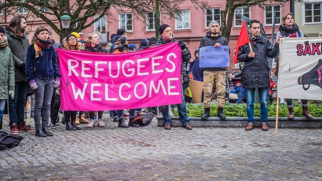 SWEDEN, Malmo: People hold a banner as they take part in a demonstration during the European March for Refugee Rights, in Malmo, on February 27, 2016. Demonstrators demanded the European authorities to take action to secure safe passage routes for refugees. - CITIZENSIDE/MAGNUS PERSSON