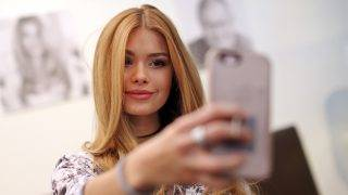 Instagram Star Pamela Reif can be seen taking a selfie at the Leipzig Book Fair in Leipzig, Germany, 24 March 2017. 2,8 Million people follow the young woman on the internet. Photo: Jan Woitas/dpa-Zentralbild/dpa