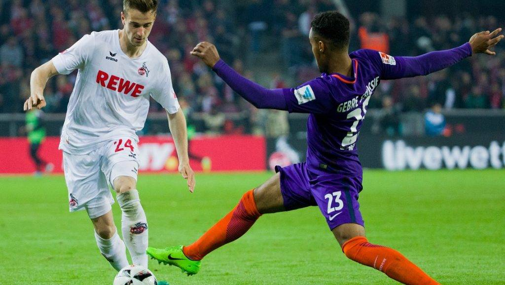 Cologne's Lukas Klunter (L) and Bremen's Theodor Gebre Selassie attempt to get possession of the ball during the German Bundesliga soccer match between 1. FCCologne and Werder Bremen in the RheinEnergieStadion stadium in Cologne, Germany, 05 May 2017.  (EMBARGO CONDITIONS - ATTENTION: Due to the accreditation guidelines, the DFL only permits the publication and utilisation of up to 15 pictures per match on the internet and in online media during the match.) Photo: Rolf Vennenbernd/dpa