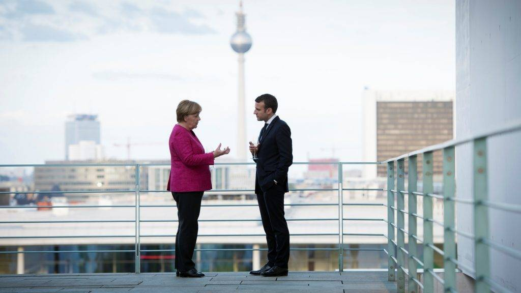 HANDOUT- Ahandout picture made available on 15 May 2017 by the Bundesregierung (German Federal Government) shows German Chancellor Angela Merkel (L)and French President Emmanuel Macron talking during Macron's inaugural visit to Germany, on the terrace of the Federal Chancellery with a view of the TVtower inBerlin,Germany, 15 May 2017.  (ATTENTIONEDITORS:FOREDITORIALUSEONLY/MANDATORYCREDITS: Guido Bergmann/Bundesregierung/dpa) Photo: Guido Bergmann/Bundesregierung/dpa