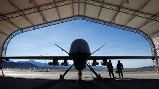 INDIAN SPRINGS, NV - NOVEMBER 17: (EDITORS NOTE: Image has been reviewed by the U.S. Military prior to transmission.) An MQ-9 Reaper remotely piloted aircraft (RPA) is prepared for a training mission at Creech Air Force Base on November 17, 2015 in Indian Springs, Nevada. The Pentagon has plans to expand combat air patrols flights by remotely piloted aircraft by as much as 50 percent over the next few years to meet an increased need for surveillance, reconnaissance and lethal airstrikes in more areas around the world.   Isaac Brekken/Getty Images/AFP