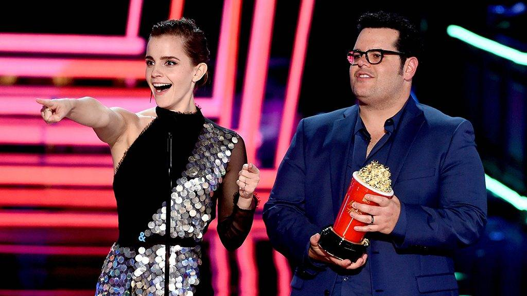 LOS ANGELES, CA - MAY 07: Actors Emma Watson (L) and Josh Gad accept Movie of the Year for 'Beauty and the Beast' onstage during the 2017 MTV Movie And TV Awards at The Shrine Auditorium on May 7, 2017 in Los Angeles, California.   Kevin Winter/Getty Images/AFP