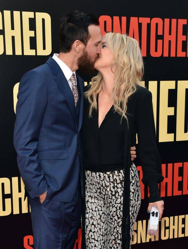 """WESTWOOD, CA - MAY 10: Musician Danny Fujikawa (L) and actor Kate Hudson attend the premiere of 20th Century Fox's """"Snatched"""" at Regency Village Theatre on May 10, 2017 in Westwood, California.   Alberto E. Rodriguez/Getty Images/AFP"""
