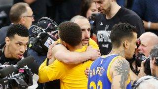 SAN ANTONIO, TX - MAY 22: Manu Ginobili #20 of the San Antonio Spurs hugs Stephen Curry #30 of the Golden State Warriors after the Golden State Warriors defeated the San Antonio Spurs 129-115 in Game Four of the 2017 NBA Western Conference Finals at AT&T Center on May 22, 2017 in San Antonio, Texas. The Golden State Warriors defeat the San Antonio Spurs 4-0 in the Western Conference Finals to advance to the 2017 NBA Finals. NOTE TO USER: User expressly acknowledges and agrees that, by downloading and or using this photograph, User is consenting to the terms and conditions of the Getty Images License Agreement.   Ronald Cortes/Getty Images/AFP