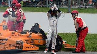INDIANAPOLIS, IN - MAY 28: Fernando Alonso of Spain, driver of the #29 McLaren-Honda-Andretti Honda, exits his car after his engine expired during the 101st Indianapolis 500 at Indianapolis Motorspeedway on May 28, 2017 in Indianapolis, Indiana.   Jared C. Tilton/Getty Images/AFP