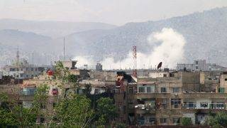 DAMASCUS, SYRIA - MAY 04: Smoke rises after Assad regime forces attacked opposition controlled Qaboun district of Damascus, Syria on May 04, 2017. Regime forces hit residential areas with ground and air strikes.