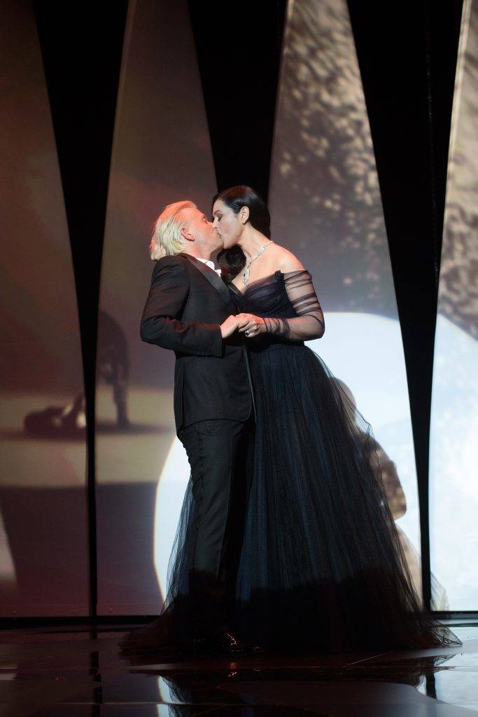 CANNES, FRANCE - MAY 17: Mistress of Ceremony, Italian actress Monica Bellucci (R) kisses French actor Alex Lutz (L) during the Opening Ceremony of the 70th annual Cannes Film Festival, in Cannes, France on May 17, 2017 Philip Rock / Anadolu Agency