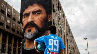 A children that dribble of Taverna Del Ferro, San Giovanni a Teduccio, peripheral of Naples EST on March 29, 2017 in front a Graffiti Revolucionario by Jorit, hand painted on wall with spray cans,  Diego Armando Maradona on wall of a building. (Photo by Paolo Manzo/NurPhoto)