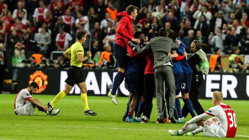 STOCKHOLM, SWEDEN - MAY 24: Players of Manchester United celebrate as players of Ajax get upset after the UEFA Europa League Final match between Ajax and Manchester United at Friends Arena in Stockholm, Sweden on May 24, 2017.  Salih Zeki Fazlioglu / Anadolu Agency