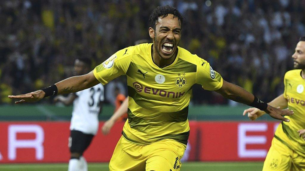 Dortmund's Gabonese forward Pierre-Emerick Aubameyang celebrates after scoring a penalty goal during the German Cup (DFB Pokal) final football match Eintracht Frankfurt v BVB Borussia Dortmund at the Olympic stadium in Berlin on May 27, 2017. / AFP PHOTO / Christof Stache / RESTRICTIONS: ACCORDING TO DFB RULES IMAGE SEQUENCES TO SIMULATE VIDEO IS NOT ALLOWED DURING MATCH TIME. MOBILE (MMS) USE IS NOT ALLOWED DURING AND FOR FURTHER TWO HOURS AFTER THE MATCH. == RESTRICTED TO EDITORIAL USE == FOR MORE INFORMATION CONTACT DFB DIRECTLY AT +49 69 67880   /